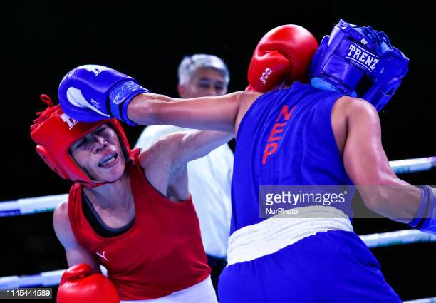 Indias Mc Mary Kom in action against Nepals Mala Rai during their bout at the 2nd edition of India Open International Boxing Tournament 2019 in...