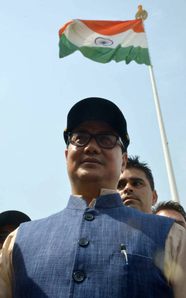 India`s Minister of State for Home Affairs Kiren Rijiju gestures after unfurling a giant national tricolour flag on a 107 foot flagpole at The...