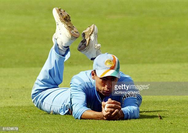 India's Mohammad Kaif dives to catch England's Nick Knight during the one day match at The Oval in London 09 July 2002 AFP PHOTO Adrian DENNIS