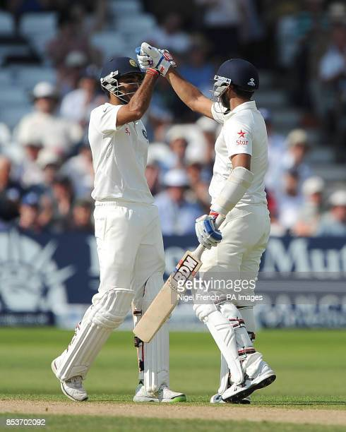 India's Mohammed Shami and Bhuvneshwar Kumar celebrate after both reached half centuries against England during day two of the first Investec test...