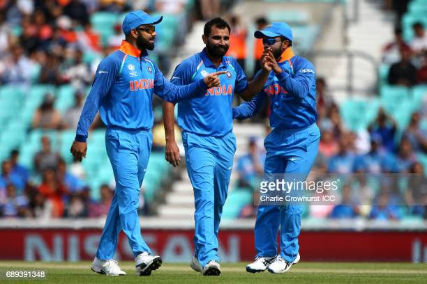 India's Mohammed Shami celebrates after taking the wicket of Martin Guptill of New Zealand during the ICC Champions Trophy Warmup match between India...