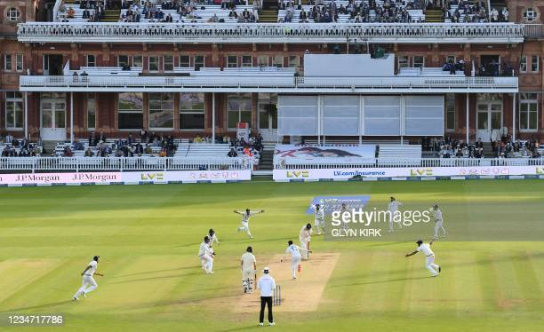 India's Mohammed Siraj celebrates dismissing England's James Anderson on the fifth and final day of the second cricket Test match between England and...
