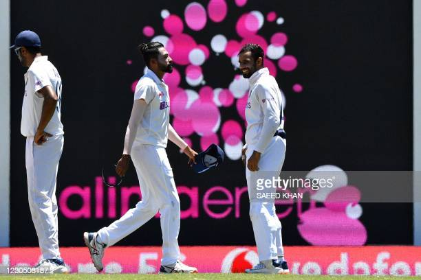 India's Mohammed Siraj walks back to his fielding position during day four of the third cricket Test match between Australia and India at the Sydney...