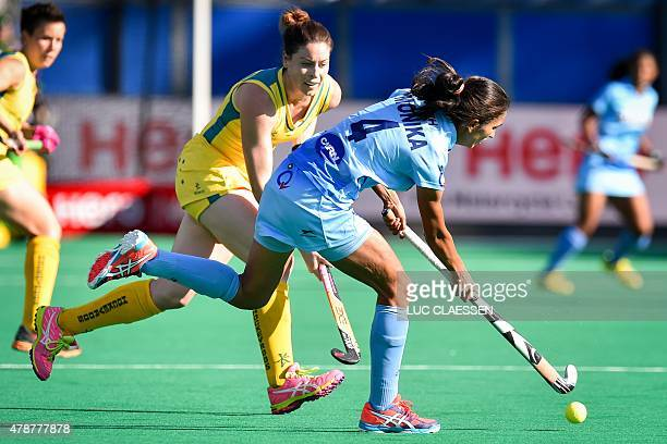 India's Monika controls the ball during the match between Australia and India in Group B of the women's group stage at the World League semifinal in...