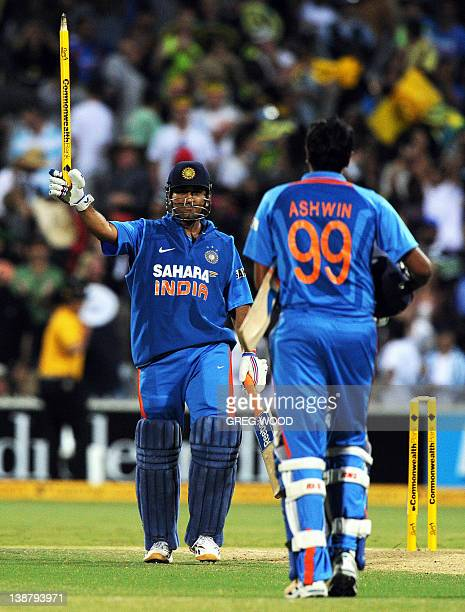 India's MS Dhoni and Ravi Ashwin of India celebrate their win during their oneday international cricket match against Australia in Adelaide on...