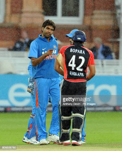 India's Munaf Patel speaks with England's Ravi Bopara during the One Day International between England and India at Lord's cricket ground, London