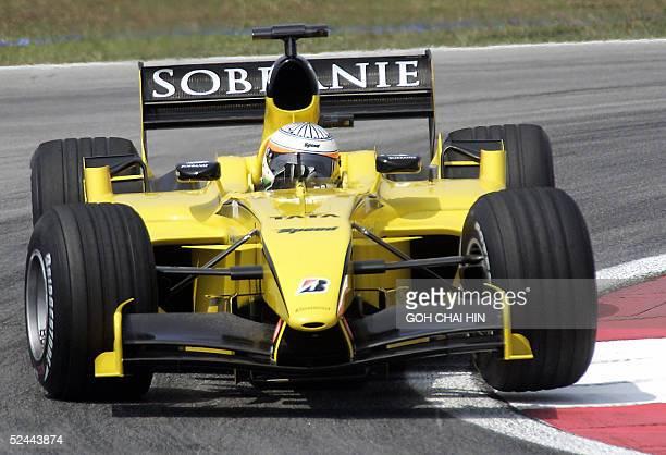India's Narain Karthikeyan of Jordan negotiates a corner during the first free practice session of the Formula One Malaysian Grand Prix at the Sepang...