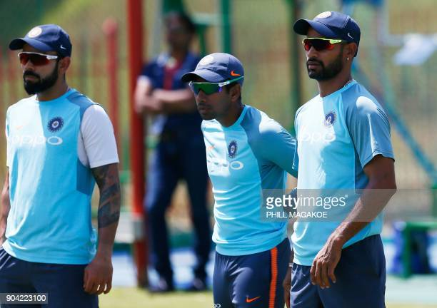 India's national cricket team captain Virat Kohli and teammates Shikhar Dhawan and Wriddhiman Saha take part in a training session at Supersport Park...