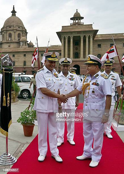 India's Naval Chief Admiral Nirmal Verma shakes hands with Bangladesh's Chief of the Naval Staff Vice Admiral Zahir Uddin Ahmed prior to a meeting in...