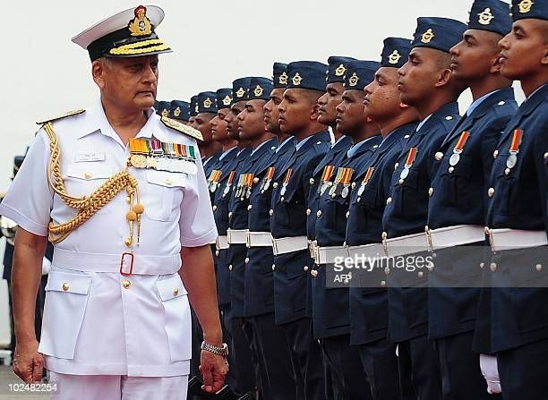 India's Navy Chief Admiral Nirmal Verma walks past guards of honor as he arrives at the Sri Lankan Air Force headquarters in Colombo on June 28 2010...