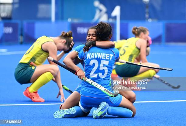 India's Neha and Navneet Kaur celebrate after defeating Australia 1-0 in their women's quarter-final match of the Tokyo 2020 Olympic Games field...