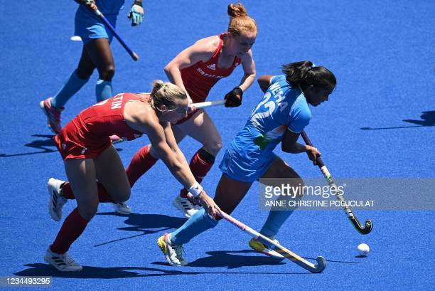 India's Neha Neha is challenged Britain's Hannah Martin and Sarah Louise Jones during the women's bronze medal match of the Tokyo 2020 Olympic Games...