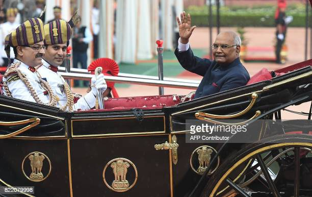 India's new President Ram Nath Kovind waves from a horsedrawn cariage during a ceremony at the Presidential Palace in New Delhi on July 25 2017 Ram...
