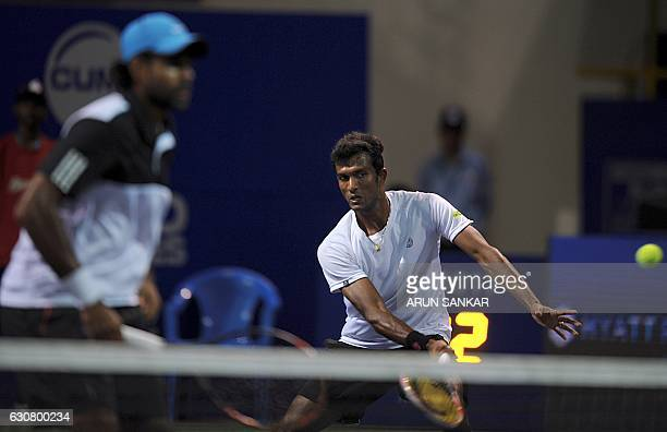 India's NSriram Balaji returns the ball to Sweden's Johan burnstrom and Andreas Siljestrom during the first round of the doubles match of the Chennai...