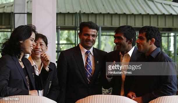 India's Olympic medal winners, Saina Nehwal, boxer Mary Kom, Gagan Narang, Yogeshwar Dutt, Sushil Kumar, during the meet with Prime Minister Manmohan...