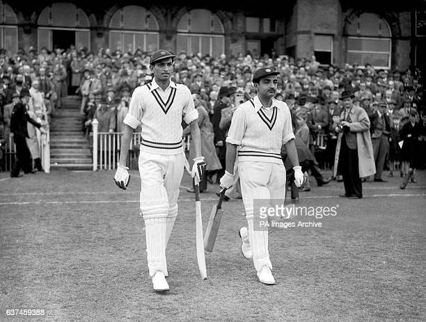 India's opening batsmen Mushtaq Ali and Vijay Merchant make their way to the crease