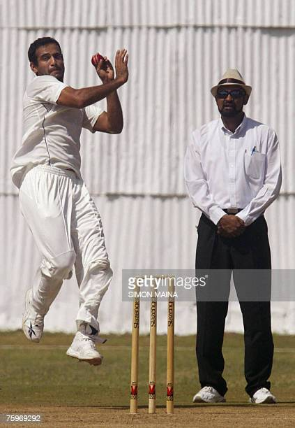 India's opening bowler Irfan Pathan bowls against Kenya's batsman David Obuya as umpire Kutub Gulamabbas looks on 05 August 2007 during a threeday...