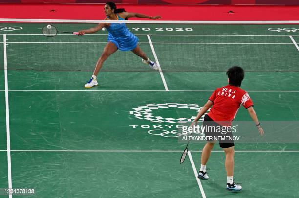India's P. V. Sindhu hits a shot to China's He Bingjiao in their women's singles badminton bronze medal match during the Tokyo 2020 Olympic Games at...