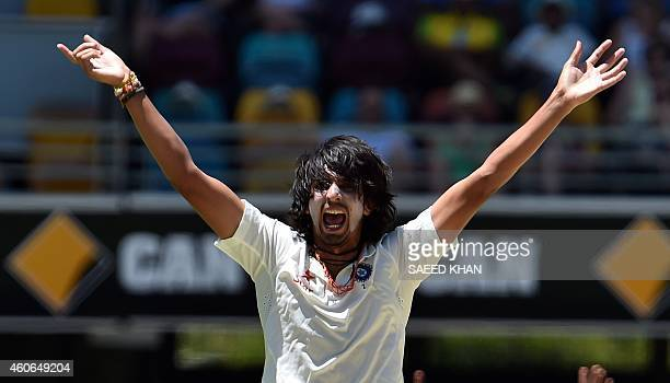 India's paceman Ishant Sharma lauds an unsuccessful leg before wicket appeal against Australia's Brad Haddin on the third day of the 2nd Test match...