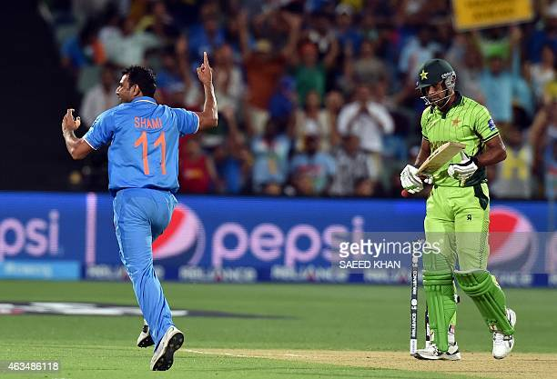 India's paceman Mohammed Shami celebrates his second wicket of Pakistan's batsman Wahab Riaz during the Pool B 2015 Cricket World Cup match between...