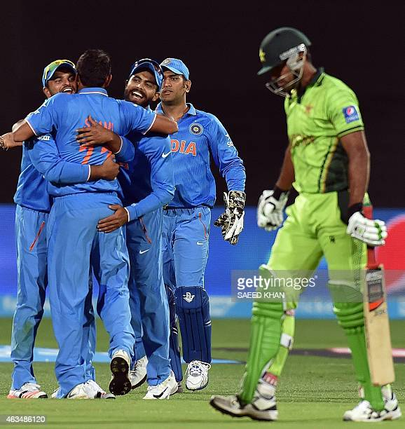 India's paceman Mohammed Shami celebrates his second wicket of Pakistan's batsman Wahab Riaz with teammates during the Pool B 2015 Cricket World Cup...