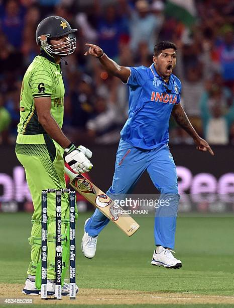 India's paceman Umesh Yadav celebrates his second wicket of Pakistan's Sohaib Maqsood during the Pool B 2015 Cricket World Cup match between India...