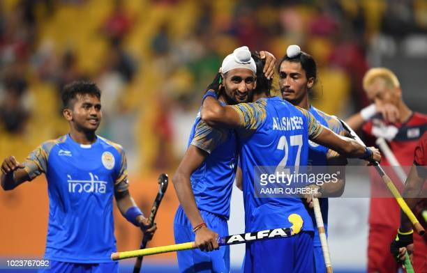 91a3e4e0a10 India s players celebrate after scoring a goal against South Korea during  the men s hockey pool A