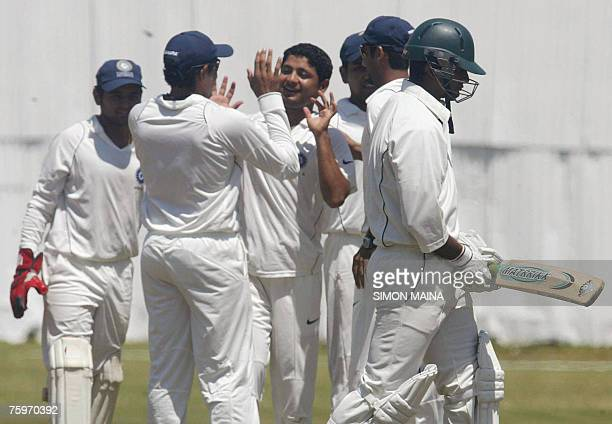 India's players celebrate after sending off Kenya's batsman Tanmay Mishra 05 August 2007 during a threeday match at the Mombasa sports club Mishra...