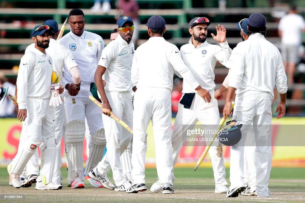 India's players celebrate after winning the fourth day of the third Test match between South Africa and India at Wanderers cricket ground in Johannesburg on January 27, 2018. India beat South Africa by 63 runs on the fourth day of the third and final Test at the Wanderers Stadium on January 27. /