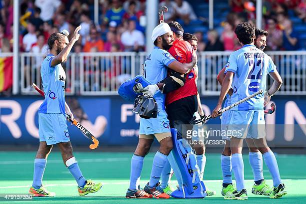 India's players celebrate after winning the quarterfinal field hockey match against Malaysia at the Field Hockey World League in Brasschaat on July 1...