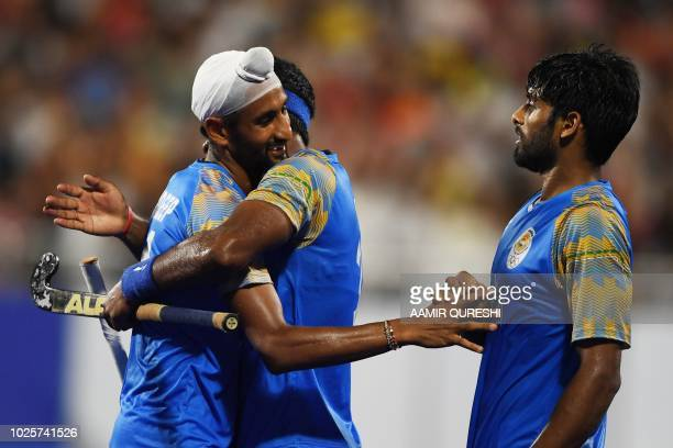 India's players celebrate beating Pakistan during the men's field hockey bronze medal match between India and Pakistan at the 2018 Asian Games in...