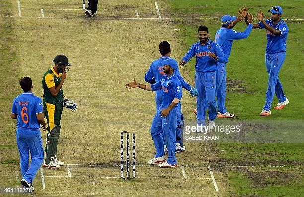 India's players celebrate victory over South Africa in the Pool B 2015 Cricket World Cup match between South Africa and India at the Melbourne...