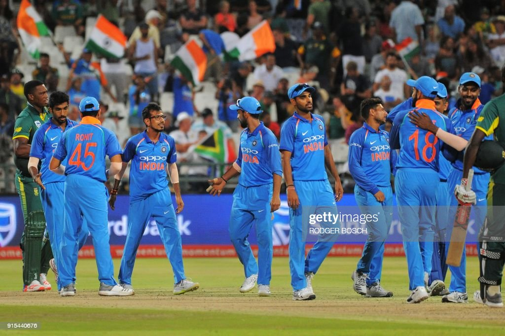 India's players celebrate winning the One Day International (ODI) cricket match between India and South Africa at Newlands Stadium on February 7, 2018, in Cape Town. /