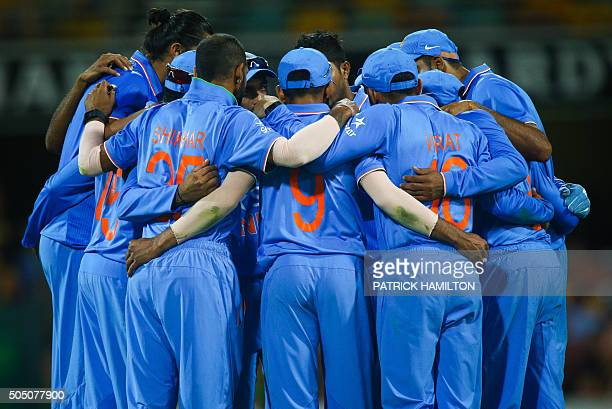 India's player's huddle together during the final drinks break during the oneday international cricket match between India and Australia in Brisbane...