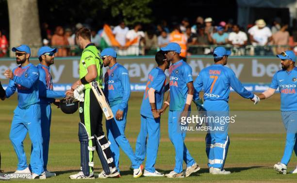 India's players shake hands after their win in the Twenty20 International cricket match between Ireland and India at Malahide cricket club in Dublin...
