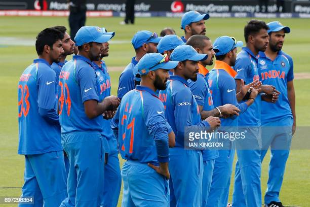 India's players watch the presentation after the ICC Champions Trophy final cricket match between India and Pakistan at The Oval in London on June 18...