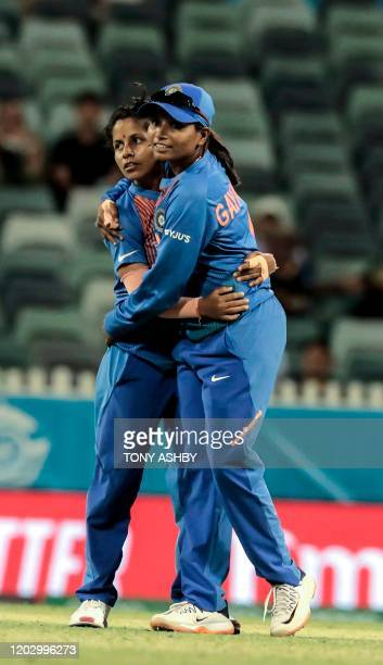 India's Poonam Yadav celebrates with teammate Rajeshwari Gaekwad for taking a wicket during the Twenty20 women's World Cup cricket match between...