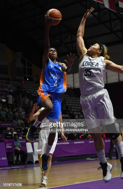 India's Prasannan Geetha Anjana goes for the basket in the women's basketball preliminary match between Unified Korea and India during the 2018 Asian...