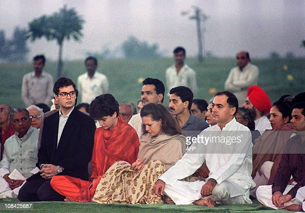 India's Premier Rajiv Gandhi accompanied by his Italianborn wife Sonia and his daughter Priyanka and son Rahul pray on his mother Indira Gandhi's...