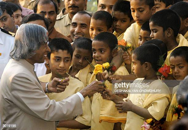India's President APJ Abdul Kalam receives flowers from a group of orphan children at The Dakshineswar Ramakrishna Adyapeath Temple complex some 20...