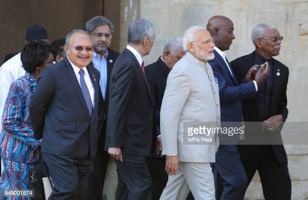India's President Narendra Modi and Prime Minister of Papua New Guinea Peter O'Neill join other Commonwealth heads of government as they arrive at...