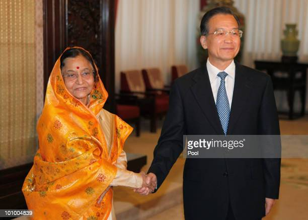 India's President Pratibha Patil shakes hands with with China's Premier Wen Jiabao during a meeting at Zhongnanhai on May 27 2010 in Beijing China...