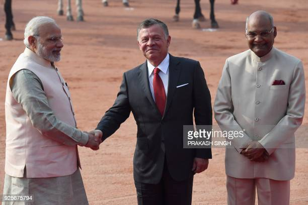 India's President Ram Nath Kovind watches as India's Prime Minister Narendra Modi shakes hands with Jordan's King Abdullah II during a ceremonial...