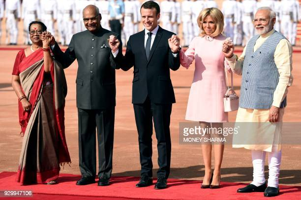 TOPSHOT India's President Ram Nath Kovind's wife Savita Kovind India's President Ram Nath Kovind France's President Emmanuel Macron his wife Brigitte...