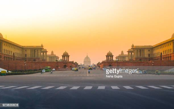 india's presidential palace (rashtrapati bhavan) at sunset - india politics stock pictures, royalty-free photos & images