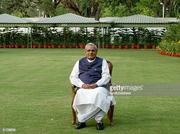 India's Prime Minister Atal Behari Vajpayee poses for photographers at his residence in New Delhi 25 March 2004 Vajpayee together with the rest of...