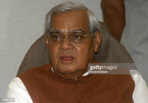 India's Prime Minister Atal Behari Vajpayee speaks at a National Democratic Alliance meeting at his residence in New Delhi 18 May 2004 The Leader of...