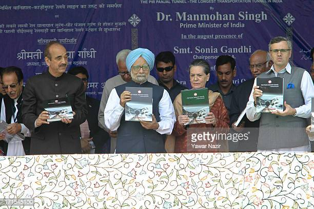 India's Prime Minister Dr Manmohan Singh Congress president Sonia Gandhi and others display books during the launch ceremony for the first train that...