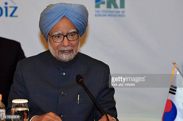 India's Prime Minister Manmohan Singh speaks during the South Korean CEO meeting in Seoul on March 26, 2012 as leaders gather for the 2012 Seoul...