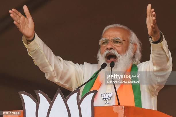 India's Prime Minister Narendra Modi addresses supporters of the Bharatiya Janata Party during a mass rally ahead of the state legislative assembly...